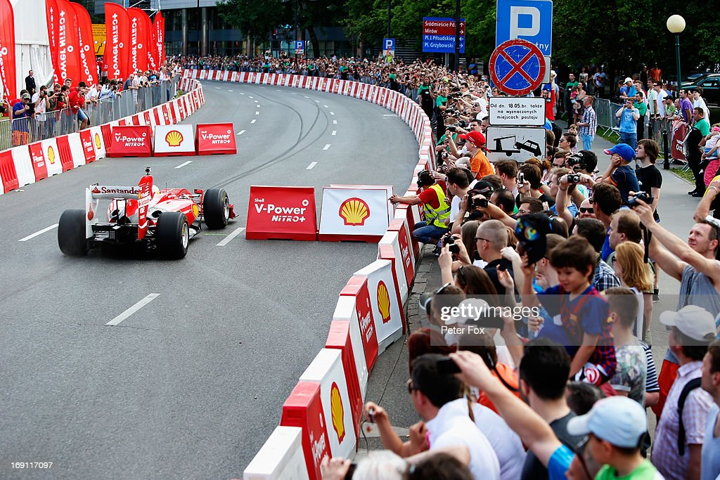 Felipe Massa of Brazil and Ferrari takes part in a demonstration run during the Shell V-Power Nitro+ Show on May 18, 2013 in Warsaw, Poland.