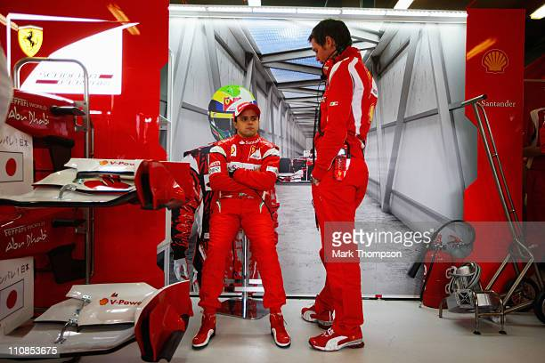 Felipe Massa of Brazil and Ferrari talks with his race engineer Rob Smedley as he prepares to drive during practice for the Australian Formula One...