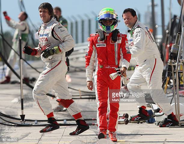 Felipe Massa of Brazil and Ferrari walks back through the pits after retiring during the Hungarian Formula One Grand Prix at the Hungaroring on...