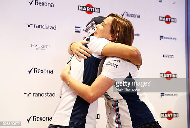 Felipe Massa of Brazil and Williams and Williams Deputy Team Principal Claire Williams hug after Felipe announced his retirement from Formula 1 at...