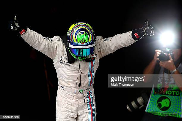 Felipe Massa of Brazil and Williams celebrates in Parc Ferme after finishing third in the Brazilian Formula One Grand Prix at Autodromo Jose Carlos...