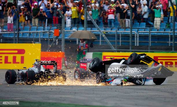 Felipe Massa of Brazil and Williams crashes with Kevin Magnussen of Denmark and McLaren Mercedes as Daniel Ricciardo of Australia and Infiniti Red...