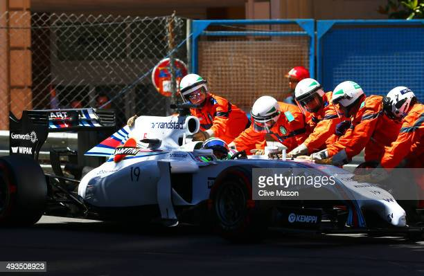 Felipe Massa of Brazil and Williams is pushed back onto the track following a collision with Marcus Ericsson of Sweden and Caterham during qualifying...