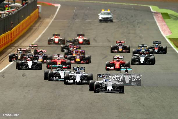 Felipe Massa of Brazil and Williams leads Lewis Hamilton of Great Britain and Mercedes GP Valtteri Bottas of Finland and Williams and Nico Rosberg of...