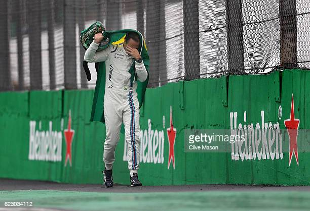 Felipe Massa of Brazil and Williams waves farewell to the Brazilian crowd during the Formula One Grand Prix of Brazil at Autodromo Jose Carlos Pace...