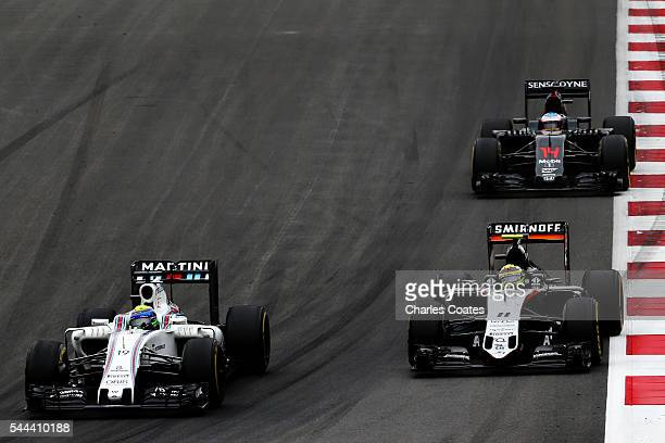 Felipe Massa of Brazil driving the Williams Martini Racing Williams FW38 Mercedes PU106C Hybrid turbo battles for position with Sergio Perez of...