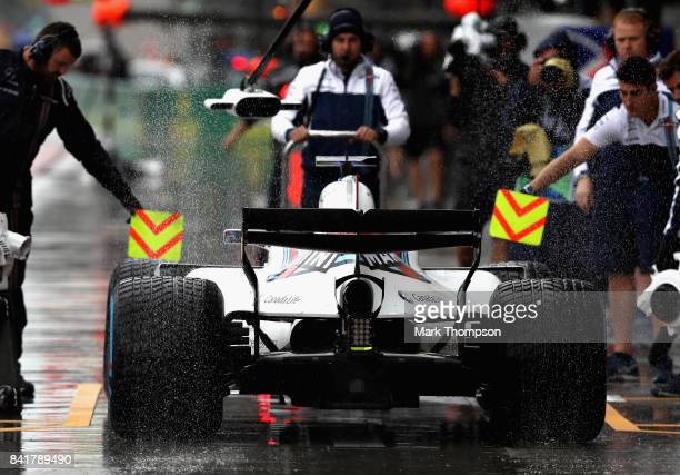 Felipe Massa of Brazil driving the Williams Martini Racing Williams FW40 Mercedes pulls into the pits during final practice for the Formula One Grand...