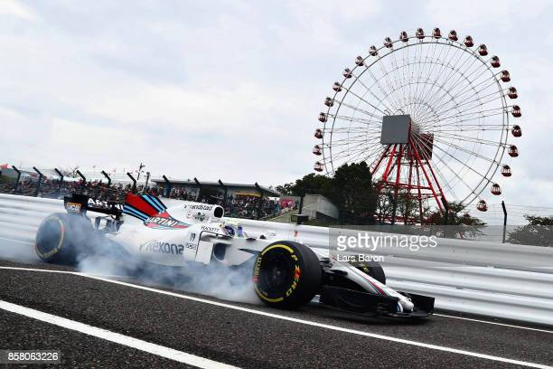 Felipe Massa of Brazil driving the Williams Martini Racing Williams FW40 Mercedes locks a wheel on track during practice for the Formula One Grand...