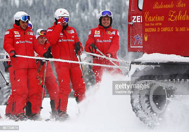 Felipe Massa of Brazil Fernando Alonso of Spain and Giancarlo Fisichella of Italy and Ferrari are seen skiing during the Wroom 2010 on January 12...