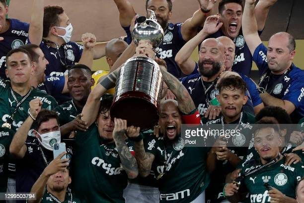 Felipe Melo and Gustavo Gomez of Palmeiras lift the Copa CONMEBOL Libertadores trophy after the final of Copa CONMEBOL Libertadores 2020 between...