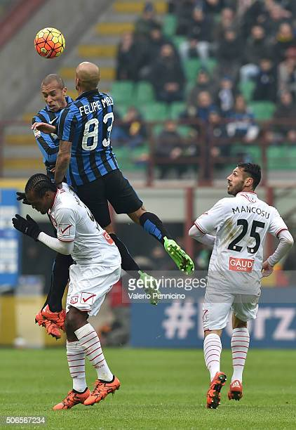 Felipe Melo and Joao Miranda of FC Internazionale Milano clashe with Jerry Mbakogu of Carpi FC during the Serie A match between FC Internazionale...