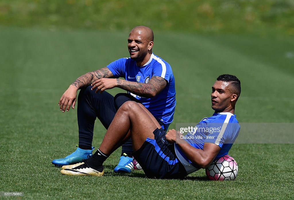 Felipe Melo (L) and Juan Jesus smiles during the FC Internazionale training session at the club's training ground at Appiano Gentile on April 18, 2016 in Como, Italy.