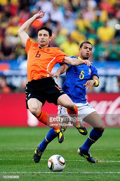 Felipe Melo of Brazil challenges Mark Van Bommel of the Netherlands during the 2010 FIFA World Cup South Africa Quarter Final match between...