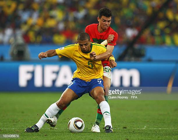 Felipe Melo of Brazil is challenged by Duda of Portugal during the 2010 FIFA World Cup South Africa Group G match between Portugal and Brazil at...