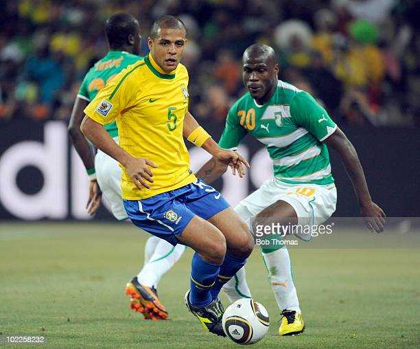 Felipe Melo of Brazil is watched by Guy Demel of the Ivory Coast during the 2010 FIFA World Cup South Africa Group G match between Brazil and Ivory...