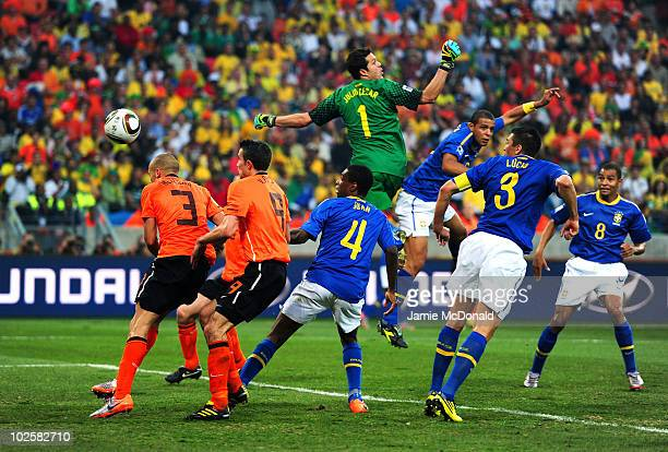 Felipe Melo of Brazil scores an own goal after a cross from Wesley Sneijder of the Netherlands hits his head as goalkeeper Julio Cesar misjudges the...