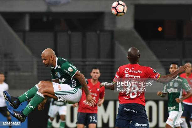 Felipe Melo of Brazil's Palmeiras jumps for the ball with Luis Cabezas of Bolivia's Jorge Wilstermann during their Libertadores Cup football match...