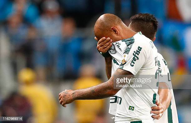 Felipe Melo of Brazil's Palmeiras reacts after being expelled during a Copa Libertadores football match against Brazil's Gremio at the Arena do...