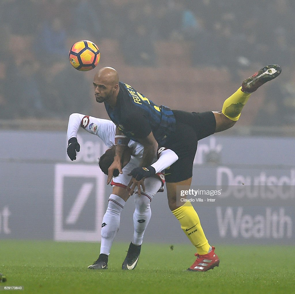 Felipe Melo of FC Internazionale of FC Internazionale (R) in action during the Serie A match between FC Internazionale and Genoa CFC at Stadio Giuseppe Meazza on December 11, 2016 in Milan, Italy.