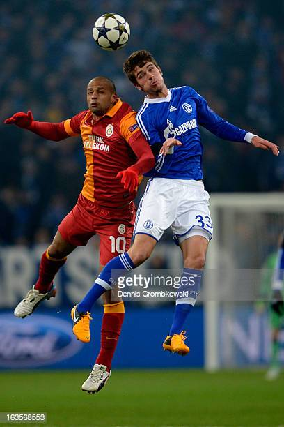 Felipe Melo of Galatasaray and Roman Neustaedter of Schalke go up for a header during the UEFA Champions League round of 16 second leg match between...