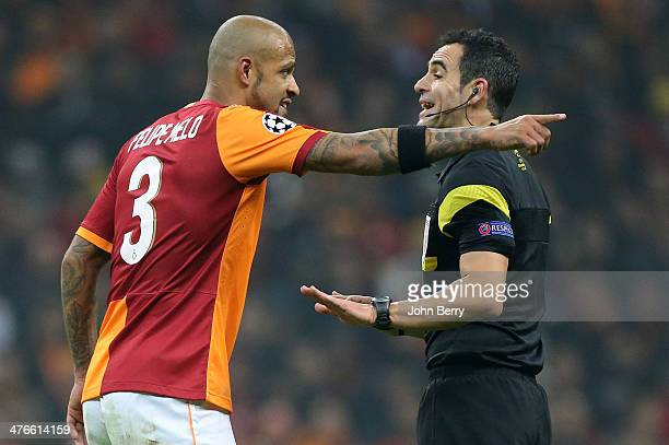 Felipe Melo of Galatasaray argues with referee Velasco Carballo of Spain during the UEFA Champions League round of 16 between Galatasaray AS and...