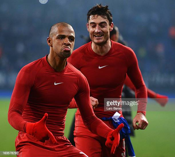 Felipe Melo of Galatasaray celebrates next to Albert Riera after the UEFA Champions League round of 16 second leg match between FC Schalke 04 and...