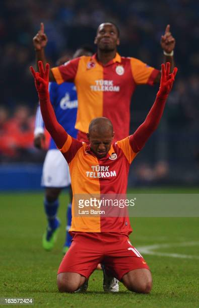 Felipe Melo of Galatasaray celebrates next to Didier Drogba after the UEFA Champions League round of 16 second leg match between FC Schalke 04 and...