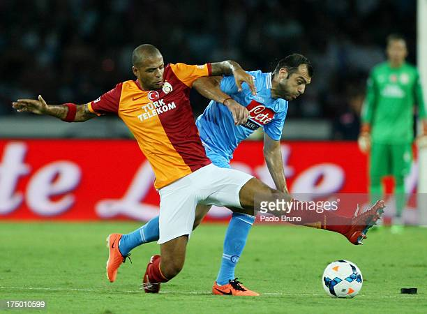 Felipe Melo of Galatasaray competes for the ball with Goran Pandev of SSC Napoli during the preseason friendly match between SSC Napoli and...