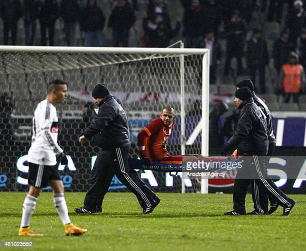 Felipe Melo of Galatasaray has to leave the field with an injury during the Turkish Spor Toto Super League soccer match between Besiktas and...