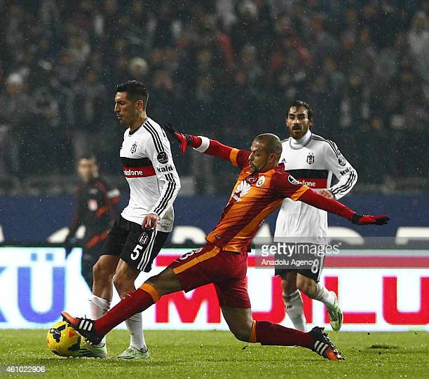 Felipe Melo of Galatasaray is in action against Jose Ernesto Sosa of Besiktas during the Turkish Spor Toto Super League soccer match between Besiktas...