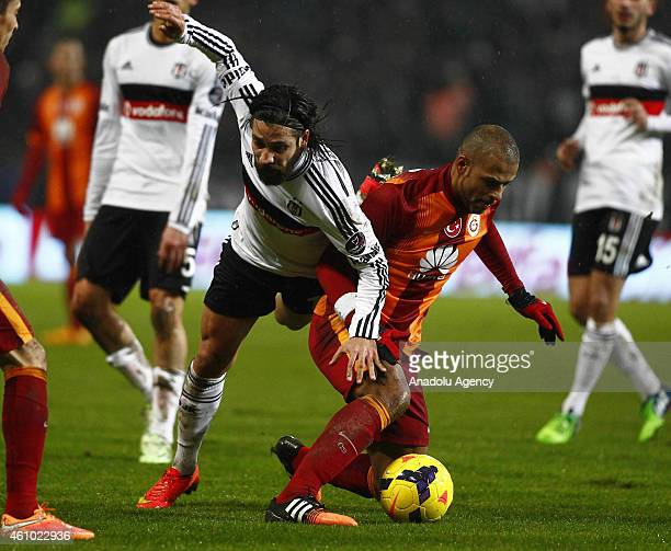 Felipe Melo of Galatasaray is in action against Olcay Sahan of Besiktas during the Turkish Spor Toto Super League soccer match between Besiktas and...