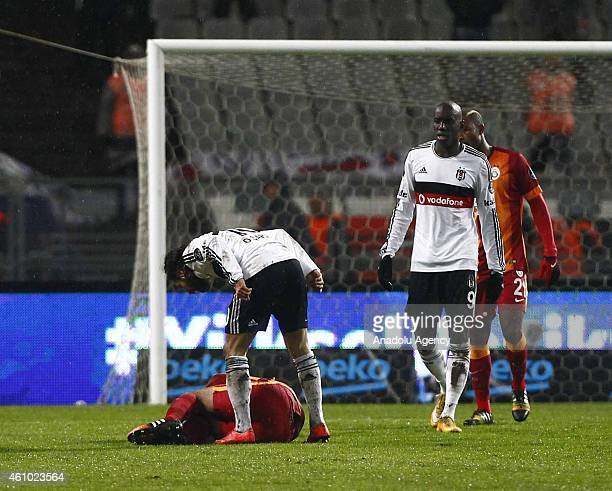 Felipe Melo of Galatasaray lays on the ground during a fight with Olcay Sahan of Besiktas during the Turkish Spor Toto Super League soccer match...