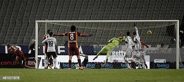 Felipe Melo of Galatasaray scores the first goal of his team during the Turkish Spor Toto Super League soccer match between Besiktas and Galatasaray...