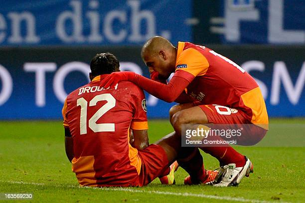 Felipe Melo of Galatasaray takes care of teammate Didier Drogba during the UEFA Champions League round of 16 second leg match between Schalke 04 and...