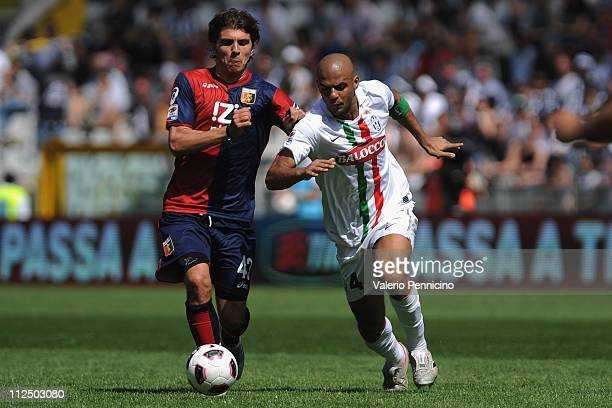 Felipe Melo of Juventus FC is challenged by Alberto Paloschi of Genoa CFC during the Serie A match between Juventus FC and Genoa CFC at Olimpico...