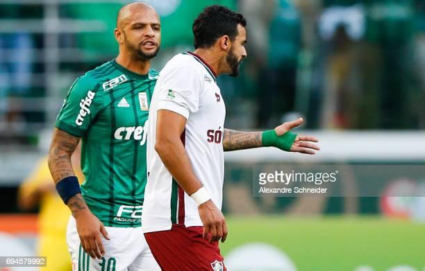 Felipe Melo of Palmeiras and henrique Dourado of Fluminense in action during the match between Palmeiras and Fluminense for the Brasileirao Series A...