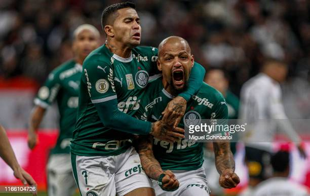 Felipe Melo of Palmeiras celebrates after scoring the first goal of his team with teammate Dudu during a match between Corinthians and Palmeiras for...
