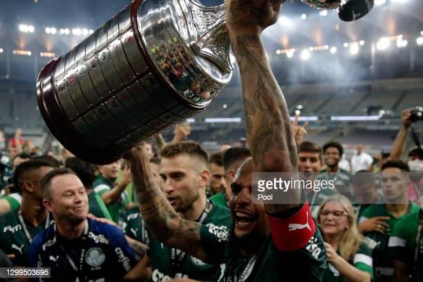 Felipe Melo of Palmeiras lifts the Copa Libertadores champions trophy after the final of Copa CONMEBOL Libertadores 2020 between Palmeiras and Santos...