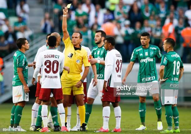 Felipe Melo of Palmeiras receives the yellow card during the match between Palmeiras and Fluminense for the Brasileirao Series A 2017 at Allianz...