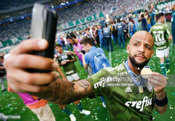 Felipe Melo of Palmeiras takes a selfie after winning the Brasileirao 2018 after the match against Vitora at Allianz Parque Stadium on December 02...