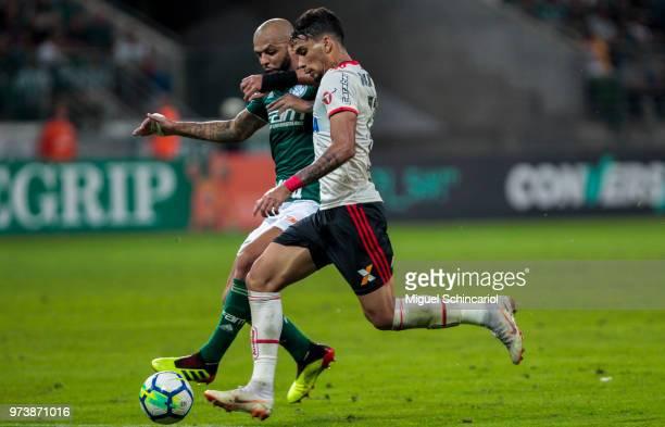 Felipe Melo of Palmeiras vies the ball with Lucas Paqueta of Flamengo during a match between Palmeiras and Flamengo for the Brasileirao Series A 2018...