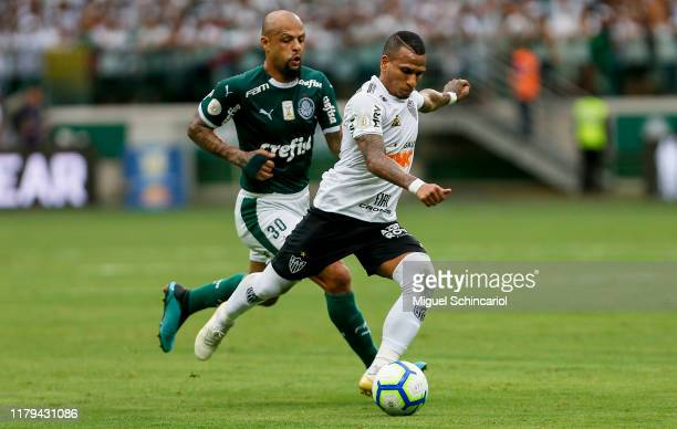 Felipe Melo of Palmeiras vies the ball with Otero of Atletico MG during a match between Palmeiras and Atletico MG for the Brasileirao Series A 2019...