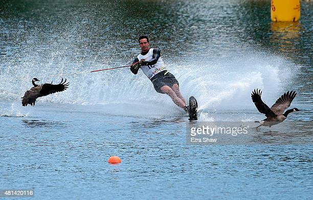 Felipe Miranda of Chile skis between two geese during the men's slalom waterski preliminary round on Day 10 of the Toronto 2015 Pan Am Games on July...