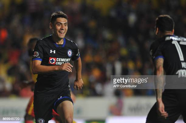 Felipe Mora of Cruz Azul celebrates his goal during the match against Morelia during their Mexican Apertura tournament football match at the Morelos...