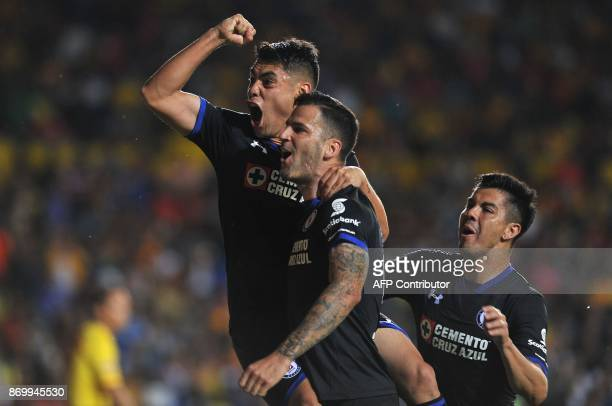 Felipe Mora of Cruz Azul celebrates his goal with his teammates during the match against Morelia during their Mexican Apertura tournament football...