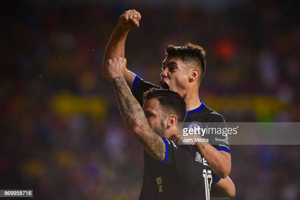 Felipe Mora of Cruz Azul celebrates with teammate after scoring the second goal of his team during the 16th round match between Morelia and Cruz Azul...