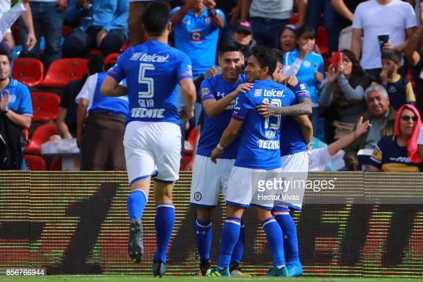 Felipe Mora of Cruz Azul celebrates with teammates after scoring the third goal of his team during the 12th round match between Pumas UNAM and Cruz...