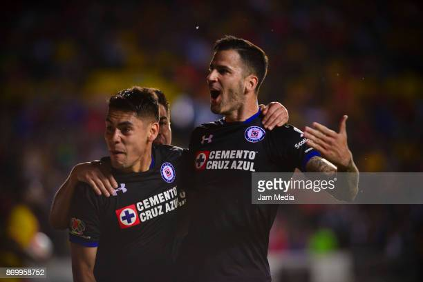 Felipe Mora of Cruz Azul celebrates with teammates after scoring the second goal of his team during the 16th round match between Morelia and Cruz...