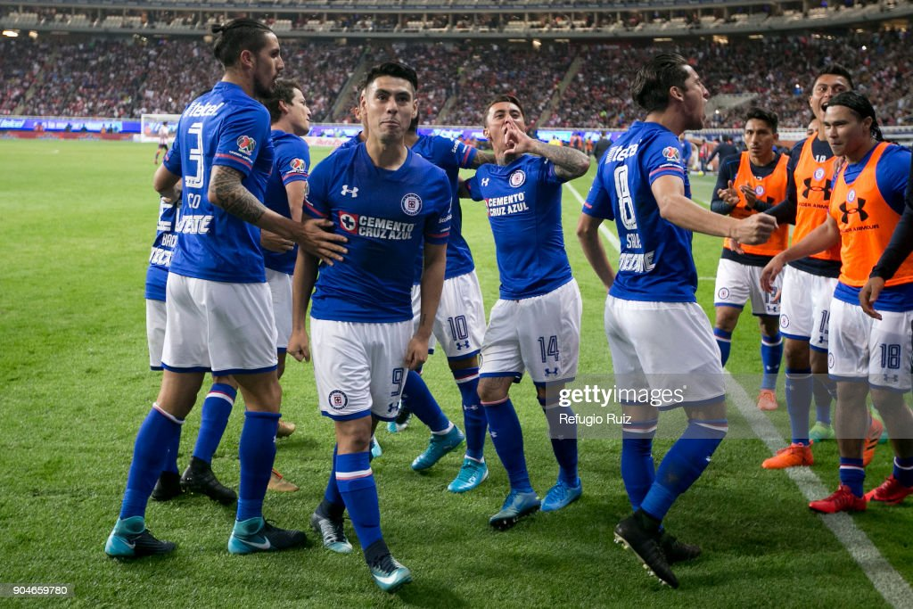 Felipe Mora of Cruz Azul celebrates with teammates after scoring the first goal of his team during the 2nd round match between Chivas and Cruz Azul as part of the Torneo Clausura 2018 Liga MX at Akron Stadium on January 13, 2018 in Zapopan, Mexico.