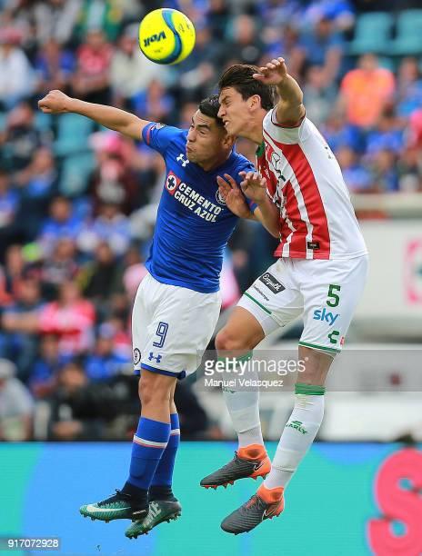 Felipe Mora of Cruz Azul struggles for the ball against Igor Lichnovsky of Necaxa during the 6th round match between Cruz Azul and Necaxa as part of...